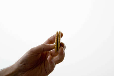Grabbing a cookie with your hand Stock Photo - 3896750