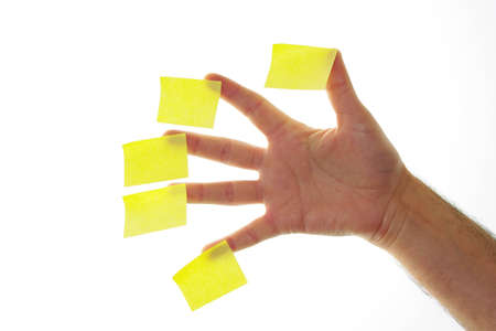 annotations: a hand with several posticks and stuck white background