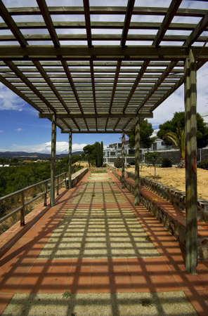 prespective: A perspective of a wooden pergola and shade