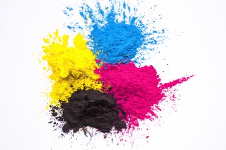 cyan, magenta, yellow and black toner on white background
