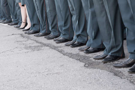 Row of legs on parade in uniform