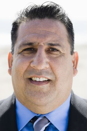 Portrait of Overweight Businessman Looking To Camera