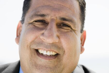 Close up Portrait of An Overweight Man Smiling To Camera photo