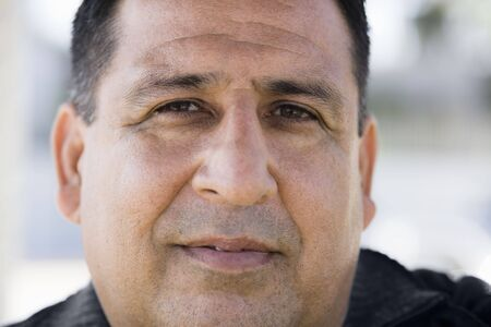 Portrait of an Overweight Man Looking Directly To Camera