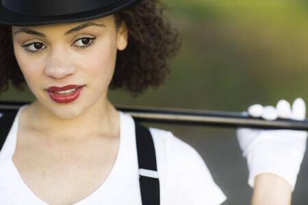tophat: Portrait of Jazz Dancer in Tophat, Gloves and Suspenders Stock Photo
