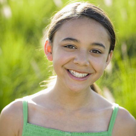 Portrait Of Tween Girl Smiling To Camera Zdjęcie Seryjne