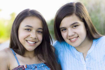 Two Tween Girls in a Park Smiling To Camera Zdjęcie Seryjne