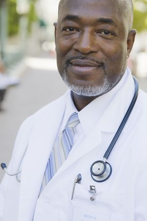 Portrait of Doctor with Stethoscope Smiling To Camera