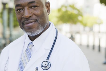 Doctor Standing Outside With Stethoscope Around Neck Stock Photo