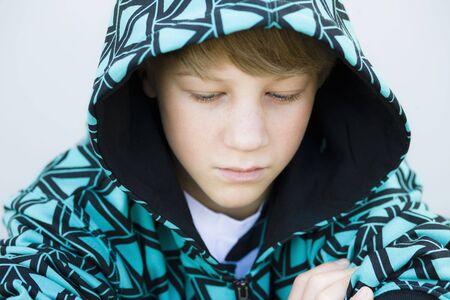 Portrait of Tween Boy in Hooded Sweatshirt Looking Down Stock Photo - 5667424