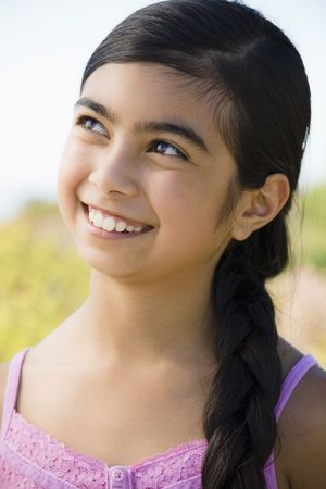 Portrait of Young Asian Girl Smiling and Looking to the sky