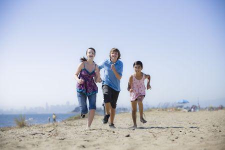 Group of Three Kids Running on the Beach