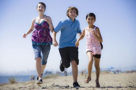 Group of Three Kids Running on the Beach