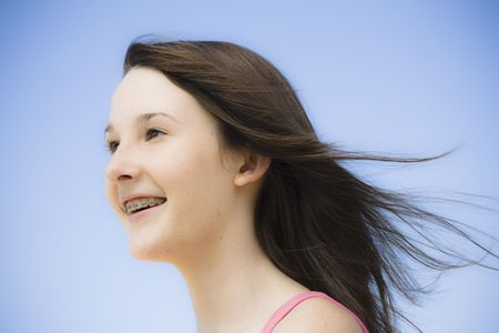Portrait of Smiling Teen Girl  with Braces Outdoors