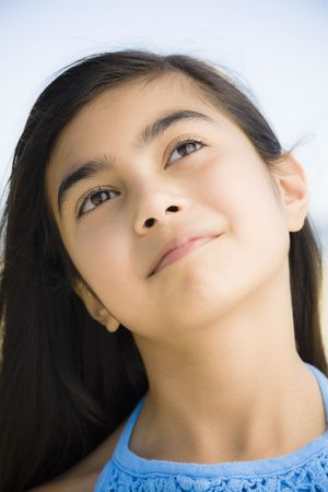 Portrait of Young Mixed-Race Girl Smiling at the Beach Stock Photo