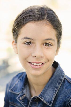 teen girl face: Portrait of Smiling Teenage Girl in Denim Jacket