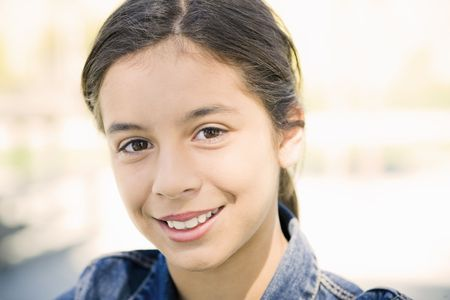 Portrait of Smiling Hispanic Teen Girl Looking To Camera Stock Photo