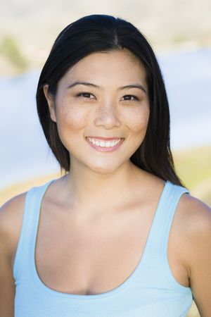Portrait of a Smiling Young Asian Woman Looking To Camera