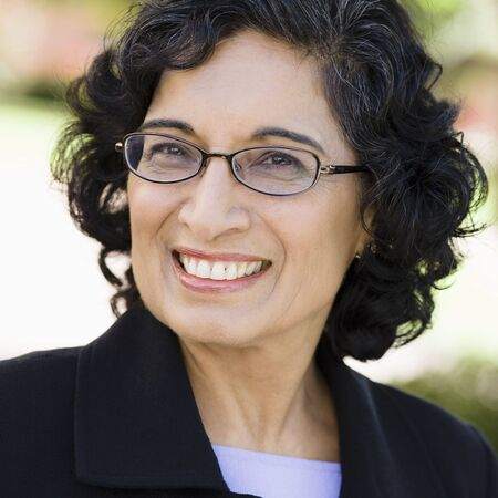 Portrait of an Indian Businesswoman Wearing Glasses Smiling Outdoors