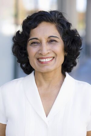 Portrait of a Smiling Indian Businesswoman Standing Outside