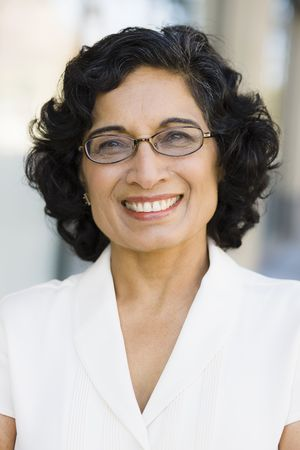 Portrait of a Smiling Indian Businesswoman Wearing Glasses