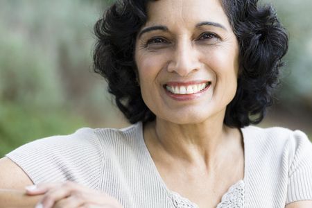 Portrait of a Smiling Mature Indian Woman Looking Directly To Camera