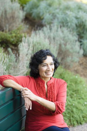 Portrait of a Mature Indian Woman Sitting on a Park Bench