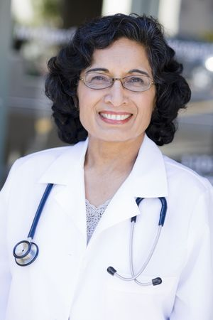 Portrait of a Mature Indian Female Doctor Standing Outdoors