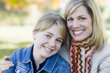 Portrait of a Mother and Daughter Sitting Together in a Park