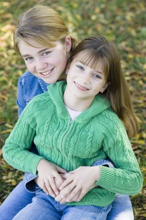 Portrait of Two Sisters Holding Each Other in a Park Stock Photo - 5945315