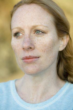 Portrait of a Pretty Redhead Woman Outdoors Banco de Imagens