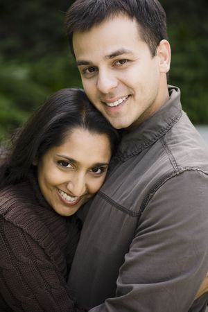 indian couple: Portrait of a Young Indian Couple Standing Outdoors