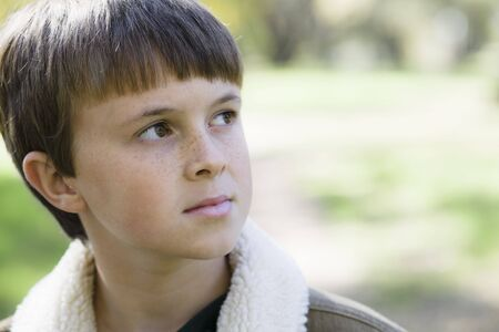 looking away from camera: Portrait of a Cute Young Boy Looking Away From Camera Stock Photo