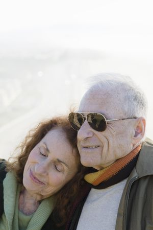 Happy Senior Couple Relaxing Together While Resting Heads on Each Other Stock Photo - 6043411