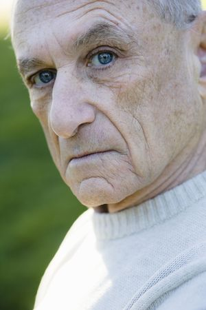 a year older: Portrait of a Serious Old Man Looking Directly To Camera