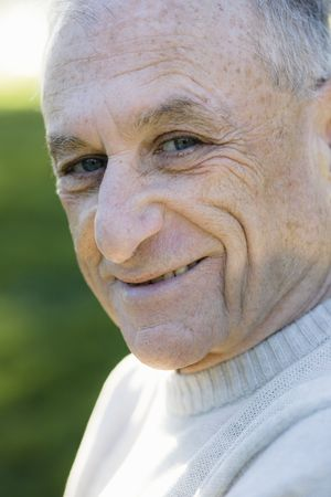 Portrait of a Smiling Senior Man Looking Directly To Camera Stock Photo - 6043391