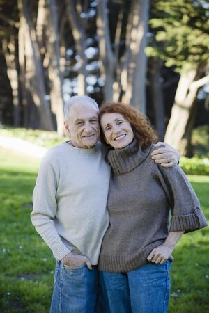 Smiling Senior Couple Holding Each Other in a Park Stock Photo - 6043381