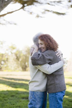 Smiling Senior Couple Hugging Each Other in a Park Stock Photo - 6043424