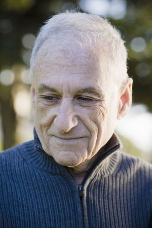 Outdoor Portrait of an Old Man in a Sweater Looking Down Stock Photo - 6043385