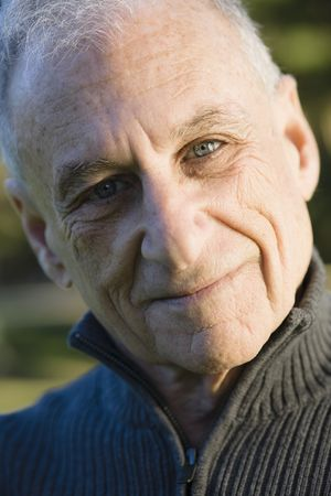 aging: Portrait of a Senior Man Smiling Directly To Camera