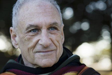 Portrait of an Old Man Wearing a Scarf Looking Away From Camera Zdjęcie Seryjne