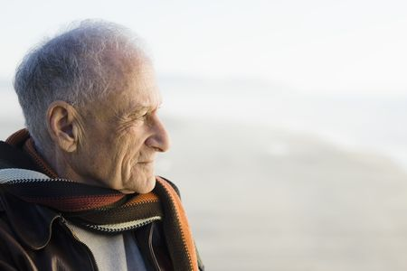 Profile of an Old Man Staring Out to The Ocean Stock Photo - 6043429