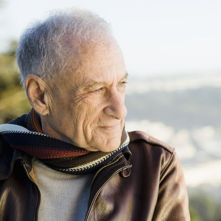 Portrait of a Senior Man in Scarf and Leather Jacket