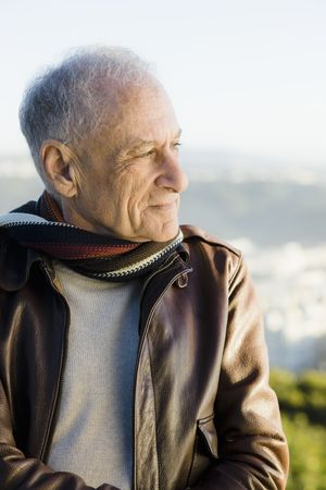 Profile of an Old Man Outdoors Wearing a  Scarf and Leather Jacket photo