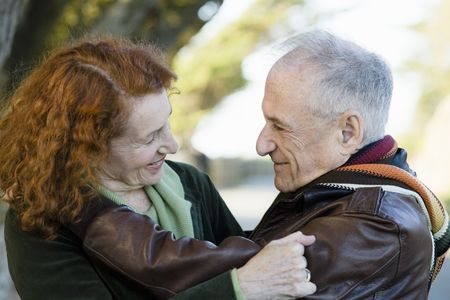 Portrait of Two Happy Seniors Smiling at Each Other Stock Photo