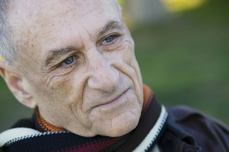 Portrait Of An Old Man Looking Away From Camera Stock Photo