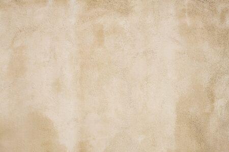 Closeup Detail of a Beige Outdoor Cement Wall