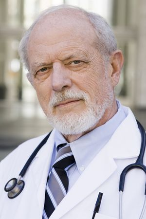 Portrait of an Old Male Doctor with a Stethoscope around His Neck