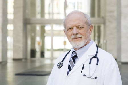 assured: Portrait of an Old Male Doctor with a Stethoscope around His Neck