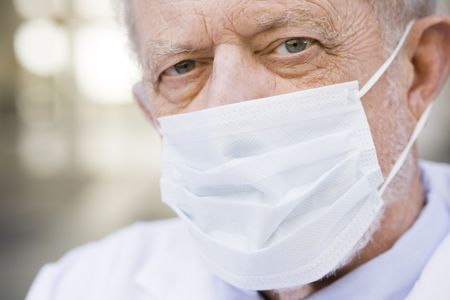 Portrait of an Old Male Doctor Wearing a Mask over His Nose and Mouth